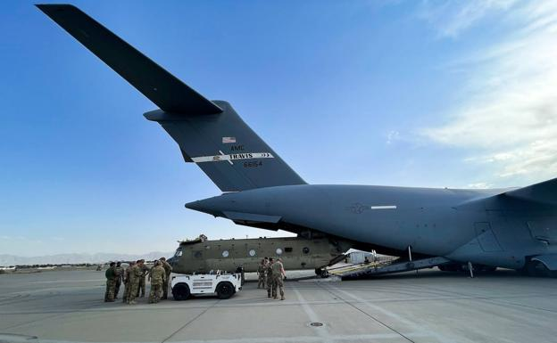 A US CH-47 Chinook helicopter is loaded onto a C-17 transport plane at Kabul airport, one of the last to take off on Monday.