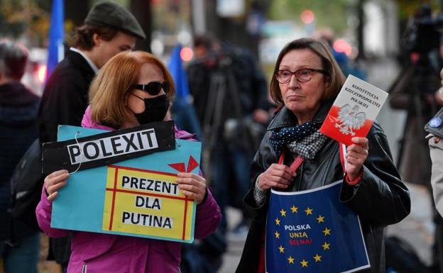 People take part in a protest in front of the Constitutional Court in Warsaw, Poland